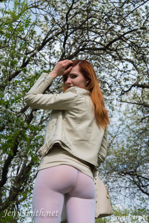 Sexy redhead Jeny Smith wears her see thru leggings in the park