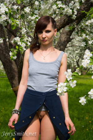 Jeny Smith wears an open skirt without panties to the apple tree
