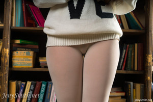 Jeny Smith reads books in the library wearing her skin tight leggings