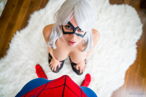 Bryci enjoys posing as the black cat in her fishnet stockings ready to give a blowjob